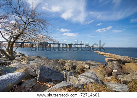 A beautiful view of New York City's Throgs Neck Bridge from the Queens side of the Long Island Sound - stock photo