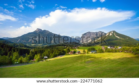 A beautiful view of the austrian alps with typical mountain houses, Austria - stock photo