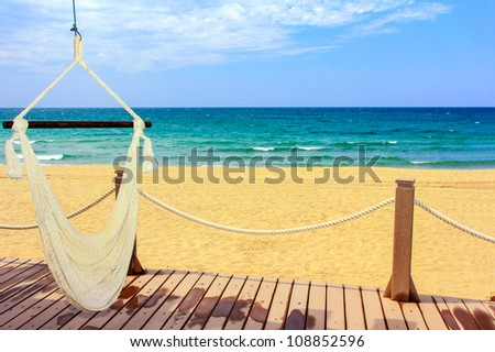 A beautiful view of the mexican coastline and the Sea of Cortez with an inviting hammock - stock photo
