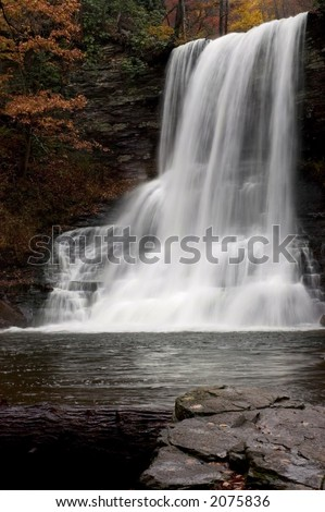A  beautiful  waterfall deep in the forests of Virginia . Fall colors along the stream add to the beauty of the scene. - stock photo