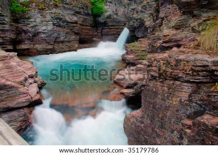 A beautiful waterfall in Glacier National Park, Montana - stock photo