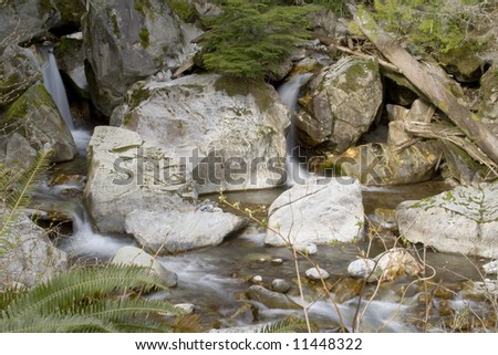 A beautiful waterfall in the northern Cascades - stock photo