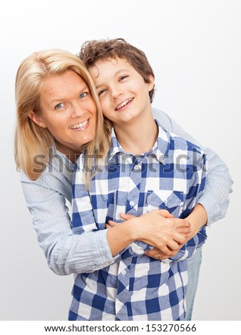 A beautiful woman and her teenage son at home. - stock photo