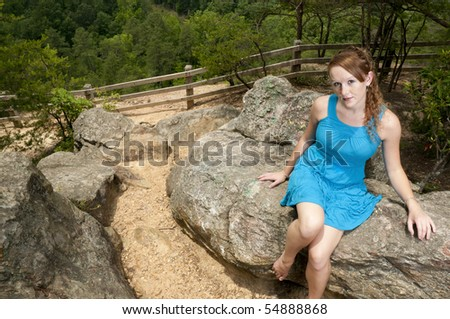 A beautiful woman at a mountain overlook