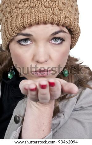 A beautiful woman blowing a kiss. - stock photo