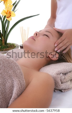 A beautiful woman getting a massage at the spa