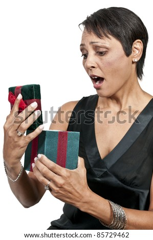 A beautiful woman holding a Christmas gift present - stock photo