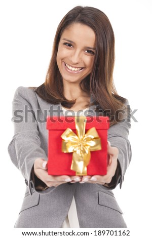 a beautiful woman holding a red gift box - stock photo