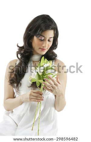 A beautiful woman holding flowers