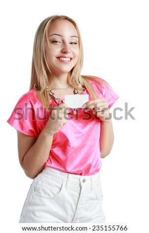A beautiful woman holds out a business or credit card Isolated on white background - stock photo