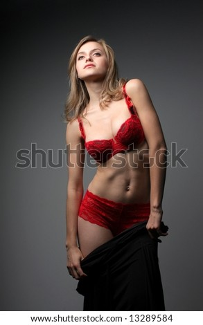 A beautiful woman in red lingerie