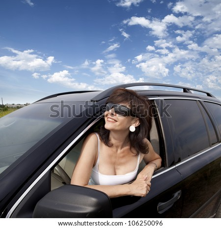 A beautiful woman in the car