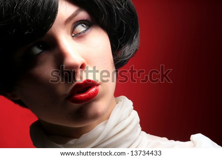 a beautiful woman in white on red - stock photo