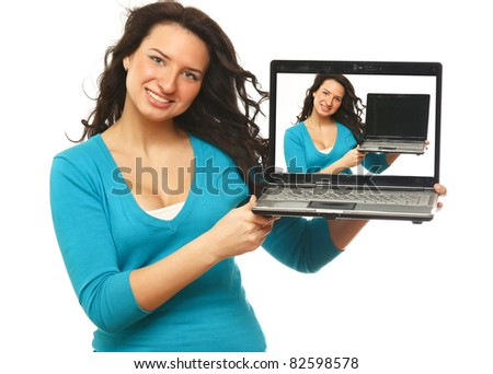 A beautiful woman is holding a laptop in her hands on white - stock photo