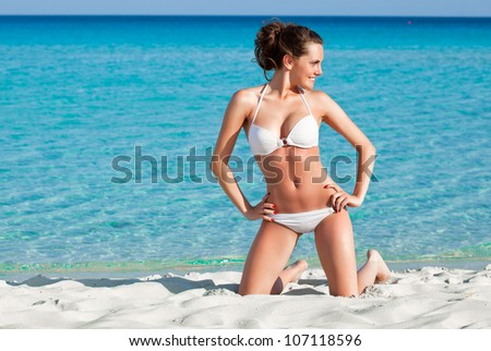 A beautiful woman is on the beach - stock photo