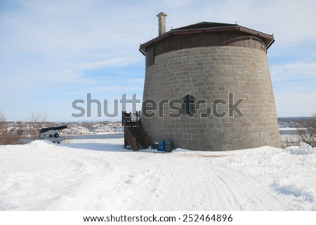 A beautiful woman on the blue sky of Quebec winter - stock photo