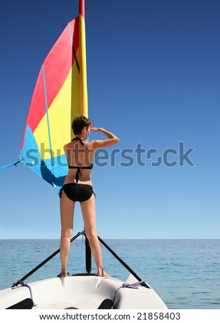 A beautiful woman on the sail boat - stock photo