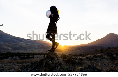A beautiful woman silhouette at sunset