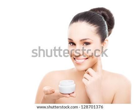 A beautiful woman using a skin care product, moisturizer or lotion