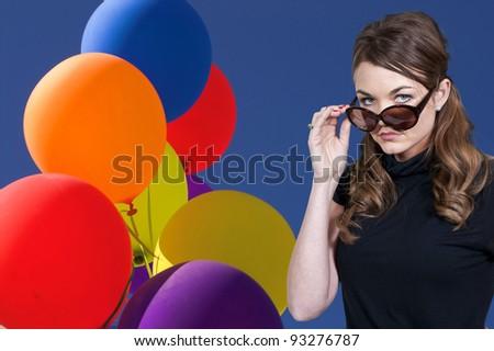 A beautiful woman wearing a pair of sunglasses - stock photo