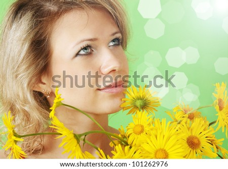 A beautiful woman with a bouquet of yellow daisies