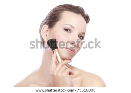 A beautiful woman with a brush - stock photo