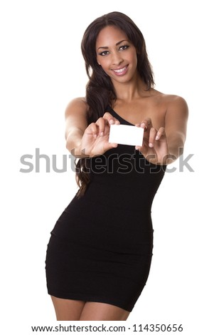 A beautiful woman with a perfect smile holds a business card. - stock photo