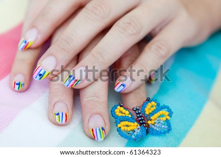 A beautiful woman with bright manicure long nails - stock photo