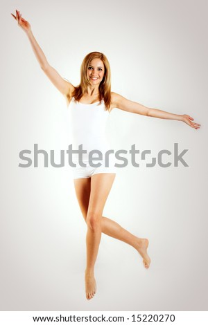 a beautiful women with white underwear is jumping with white underwear - stock photo