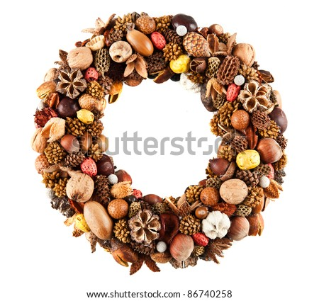 A beautiful wreath made of various dry fruits - stock photo