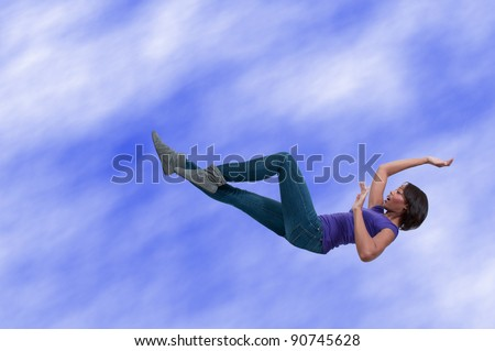 A beautiful young black African American woman falling through the sky
