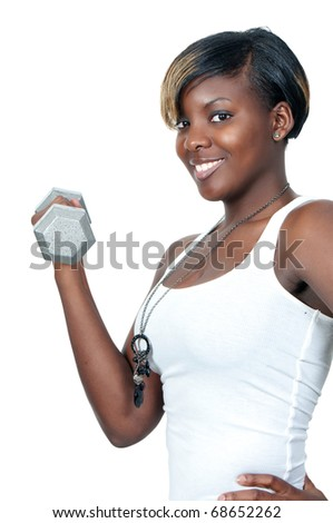 A beautiful young black African American woman working out with a dumbbell weight - stock photo
