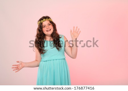 A beautiful young brunette girl is posing in the studio. She is slightly overweight. - stock photo