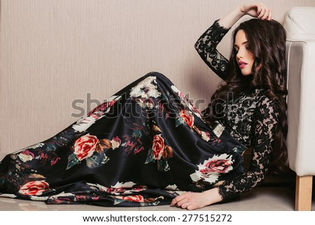 a beautiful young brunette woman with long hair lying - stock photo