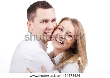 A beautiful young couple in love poses and smiling