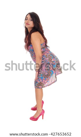 A beautiful young East Indian woman standing full length in a colorful