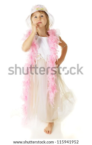 A beautiful young elementary girl looking up in a long white dress with a pink boa and matching hat.  On a white background.