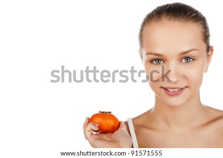 a beautiful young girl holds a delicious persimmon, a portrait of a beautiful young girl with fruits, isolated on white - stock photo