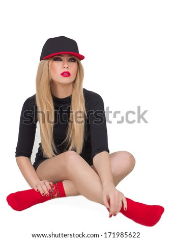 a beautiful young girl in a cap on white background