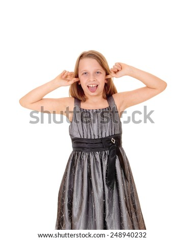 A beautiful young girl standing for white background with her hands in her ears and showing her thong.  - stock photo
