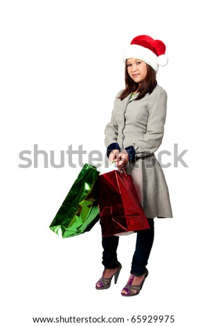 A beautiful young Hispanic woman on a shopping spree