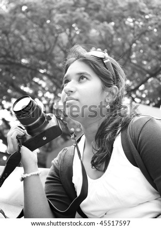 A beautiful young pakistani photographer in grey scale tone