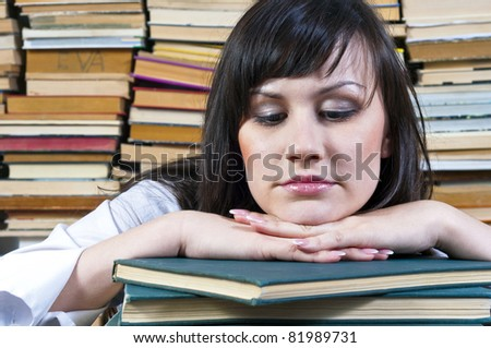A beautiful young student girl with her books - stock photo