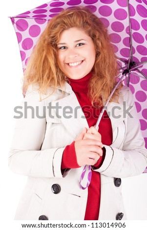A beautiful young woman dressed for winter - stock photo
