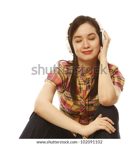 A beautiful young woman enjoying some music (on white background)