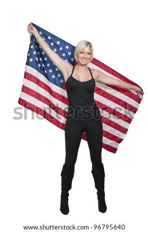 A beautiful young woman holding an American flag - stock photo