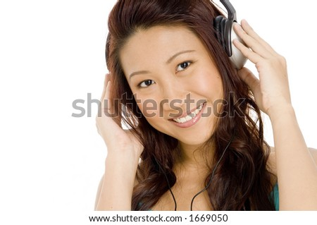 A beautiful young woman in big headphones