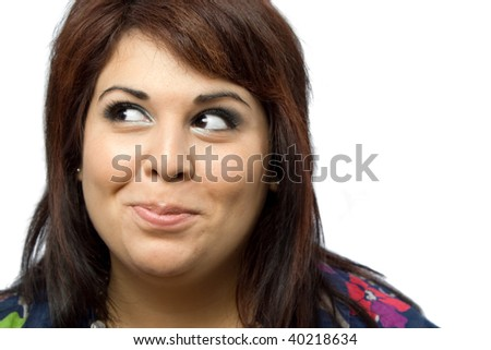 A beautiful young woman isolated over white with a funny mischievous look on her face. - stock photo