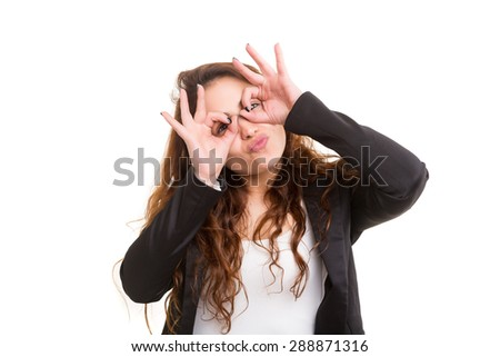 A beautiful young woman making a silly expression, isolated over white - stock photo