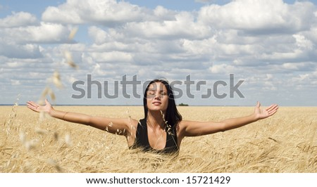 a beautiful young woman relaxing on a meadow